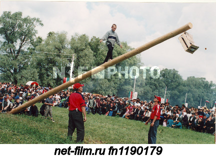 "Participants of the contest ""Walking on a suspended log"" during the Tatar national holiday Sabantuy..."