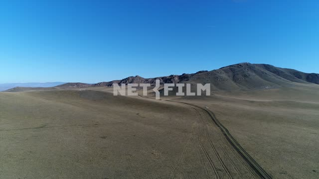 Aerial photo, survey copter. Mountains in the distance, sky high, open spaces. Nature. Aerial...