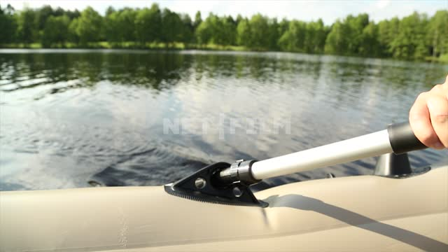 Man rowing paddle, rubber boat, lake, light, nature. Man rowing paddle, rubber boat, lake, light,...