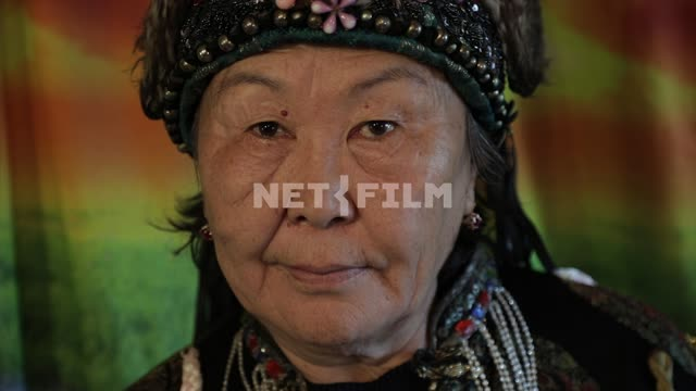 An elderly shaman looking at camera, portrait of an elderly woman An elderly shaman looking at...