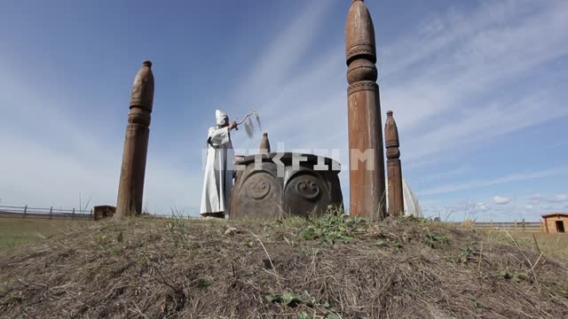 Yakut priest conducts the ceremony in a sacred place, the High sky, clouds, nature, ritual,...
