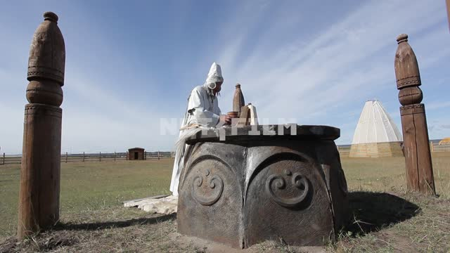 Yakut priest conducts the ceremony in a sacred place. Yakut priest conducts the ceremony in a...