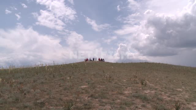 People in the distance on the hill. Wind, Nature, faith , religion, sky, nature, clouds, mountains...