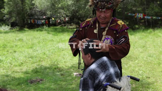 Shamanic healing ceremony, people in the clearing, Shamanism, exorcism, Tuva, faith, religion,...