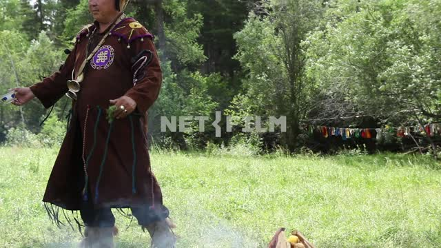 The Supreme shaman of Russia Dopchun Kara-ool, Tulasiewicz on the ritual feeding of the spirits,...