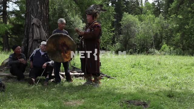 The Supreme shaman of Russia Dopchun Kara-ool, Tulasiewicz on the rite, ignites the fire, beats his...