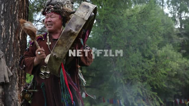 The Supreme shaman of Russia Dopchun Kara-ool, Tulasiewicz on the rite, beats the drum, People are...