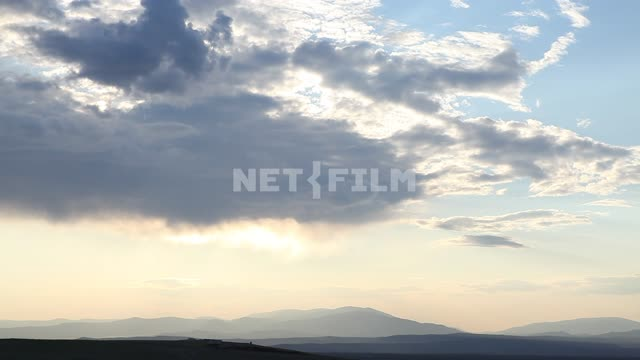Sky, clouds, nature, dark mountains in the distance Sky, clouds, nature, dark mountains in the...