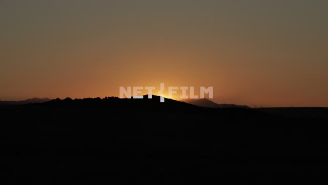 The sunset, the Sun goes behind a low hill, nature, sky The sunset, the Sun goes behind a low hill,...