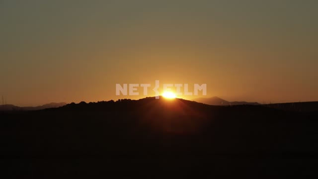 Sunset The sun goes behind a low hill, nature, sky Sunset The sun goes behind a low hill, nature,...