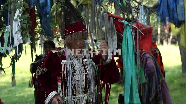 Colorful shaman with a pipe preparing for the ritual, Shamanism, Ethnography, religion, faith,...