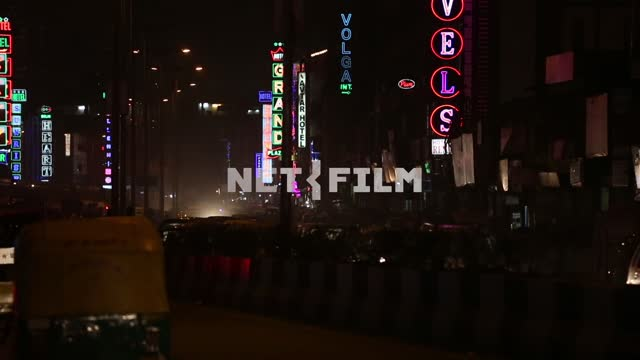 Neon signs in the evening the streets of the southern city Neon signs, evening street, city life,...
