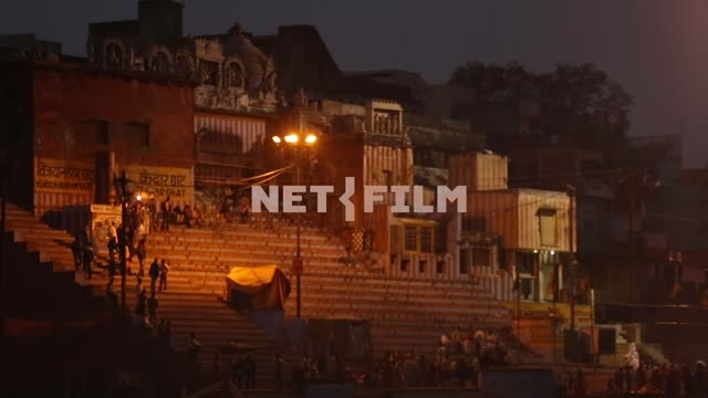 Stairs of a temple in Varanasi, shooting from boats Varanasi, temple, night, lights, people, stairs