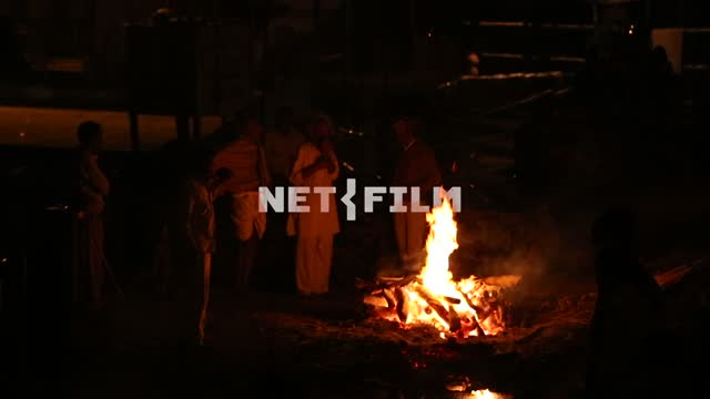 a night of Indian men standing around the campfire fire, fire, Indian men, exoticism, Ethnography