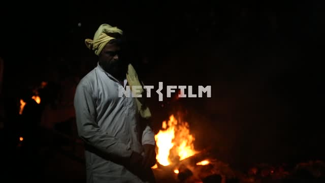 Indian sorcerer night stands amid the fires Indian sorcerer, night, fire, fire, exotics, Ethnography