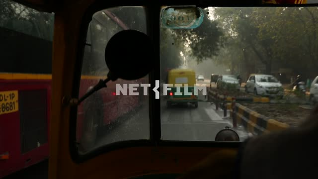 cars on the Indian road, the view from the window of an Indian taxi Indian trail, cars, window,...