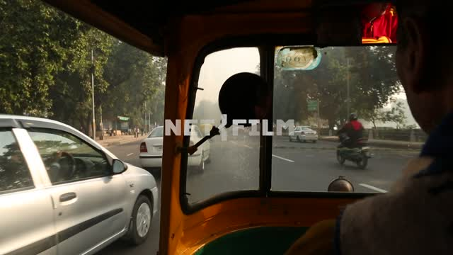 the road from riding it on the transport, taken from inside an Indian taxi Indian trail,...