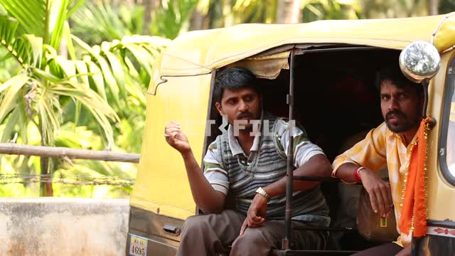 Indian men sit in the car, one standing by the car, talking car, palm trees, Indian men, exoticism,...