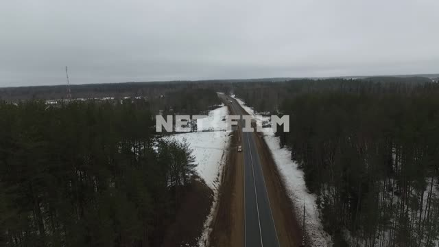 Top view on a winter road. Car, winter, drone, forest, pine, road, snow, stripes, road trip,...
