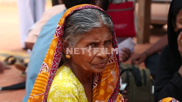 Elderly the Indian woman in national clothes Elderly the Indian woman in national dress, portrait,...