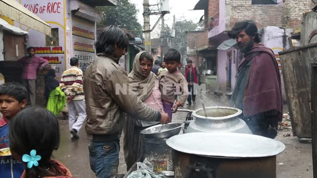 The street food vendors cooking right on the street in the slums Street food, cooking, selling,...