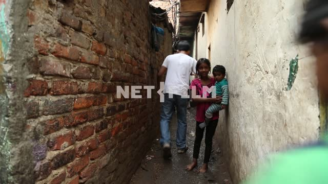 People walk on a narrow street in the Indian slums People,the poor, narrow street, slum