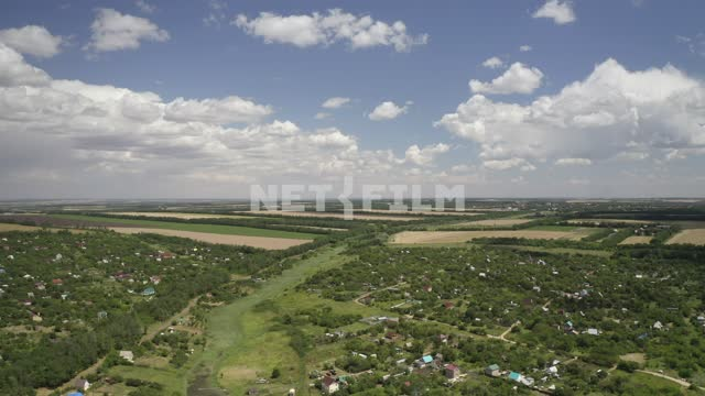 Aerial photo of country towns in the South of Russia, in the distance, wheat fields Location:...