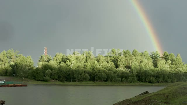 Rainbow in a forest Rainbow, trees, river, shore, forest, tower, sun, summer, day, light, nature,...
