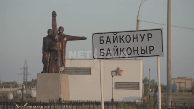 Entrance to the city and road sign Baikonur. Road...