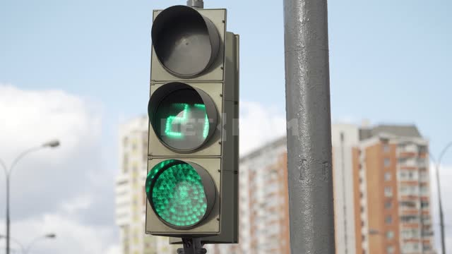 Traffic light operation, green and red. Traffic lights for cars on the background of residential...