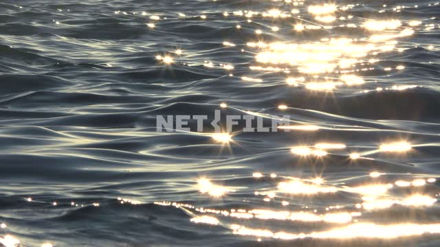 The sun sparkles on the water, splashes of waves in the sun's rays Sea, nature, summer, landscapes,...