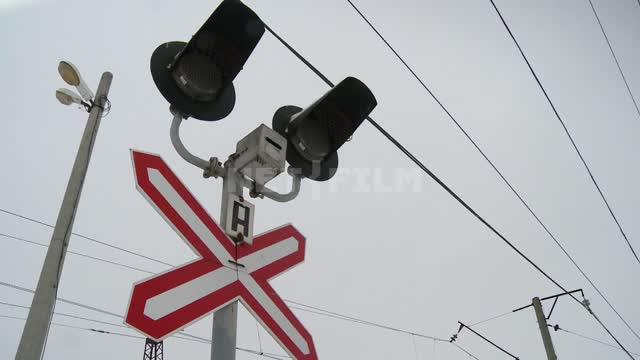 Traffic light at the railway station winter, traffic light, crossing, tracks, railway, road, rails,...