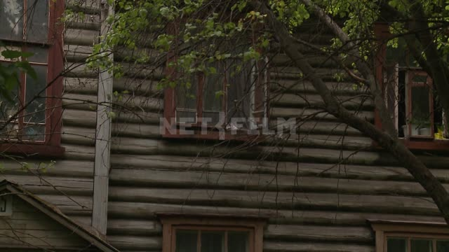 summer, rustic two-story house, PNRM. at the open window on the second floor village, village...