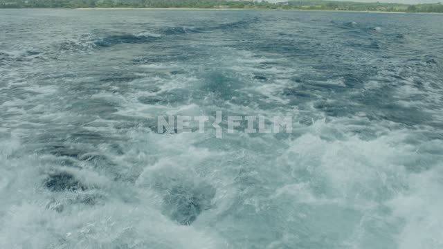 Sea waves Nature. General plan. Cloudy Shore Sea Sea foam Shooting from boat...