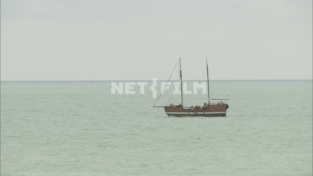 Yacht in the sea Nature. General plan. Sea. Yacht Cloudy sky. Summer Day Sunny