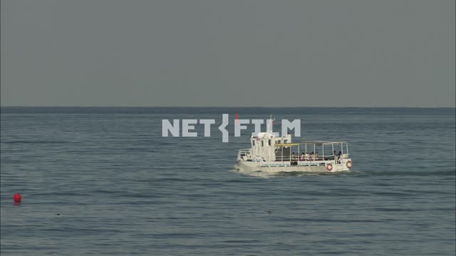 Pleasure boat sails on the sea Nature. General plan. Blue sea. The boat is a...