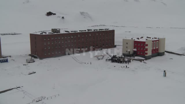 Shot from a helicopter of the buildings on the square in the village of Barentsburg. Russian North,...