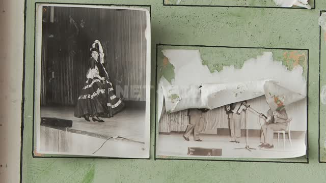 "Old photos of the performances on the wall of an abandoned D/To the village ""Pyramid"". Russian..."