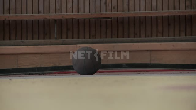"The ball on the floor in an abandoned gym of the sports complex of the village ""Pyramid"". Russian..."
