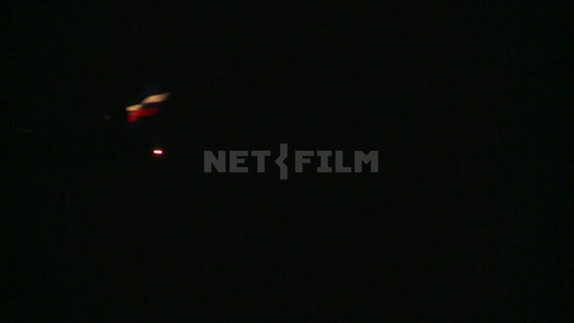 The plane at night with headlights accelerates down the runway and takes off. Airport, takeoff,...