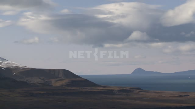 Views of the hills, the sea and the mountains. Russian North, hills, sea, mountains, clouds, day,...