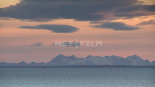 The sea and the mountains. Russian North, sea, mountains, clouds.