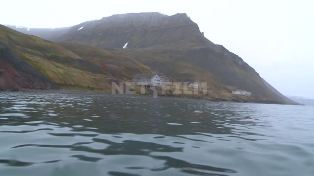 The view from the boat to shore and buildings in the village Pyramid. Russian North, building,...