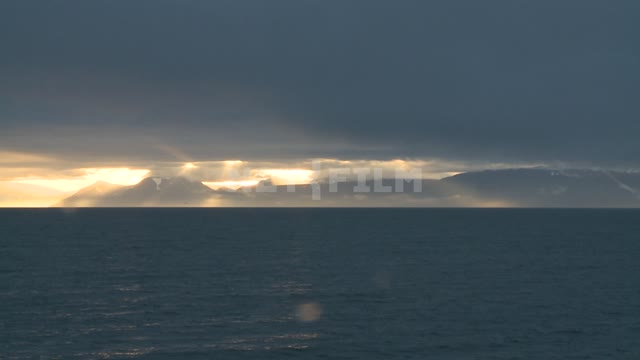 Вид на горы с моря. Russian North, mountains, sea, clouds, clouds, sunset.