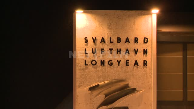Sign Airport Svalbard Longyear - the name of the airport Svalbard Lufthavn Longyear. Russian North,...