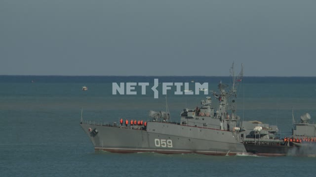 Warship goes to sea. Sevastopol. Day. Sea. Ship. Pier. Pier. Coast. Lighthouse. Transport.