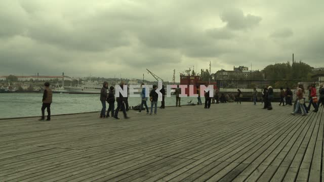Group of people walking on the pier of the ships. Sevastopol. People. Mainly...
