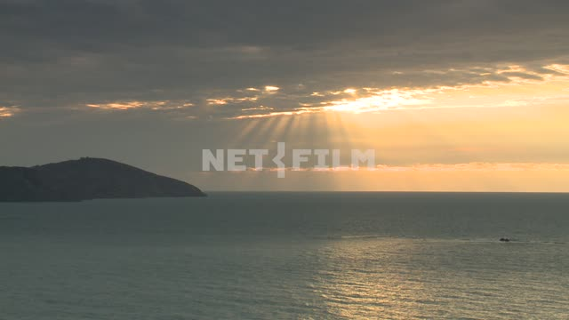 The sea and the mountain. Koktebel, sea, mountain, sun, rays, clouds, clouds.