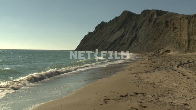 A view of the sandy shore and the Cape. Koktebel, shore, beach, sand, surf, waves, Cape, mountains,...