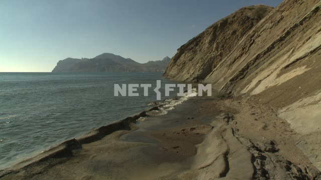 A view of the sandy shore, the mountains and the sea. Koktebel, sea, shore, beach, sand, landslide,...